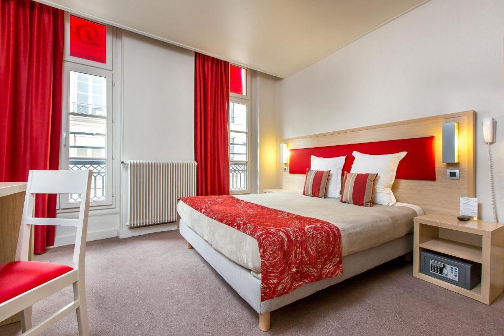 Tempat tidur dalam kamar di D'win