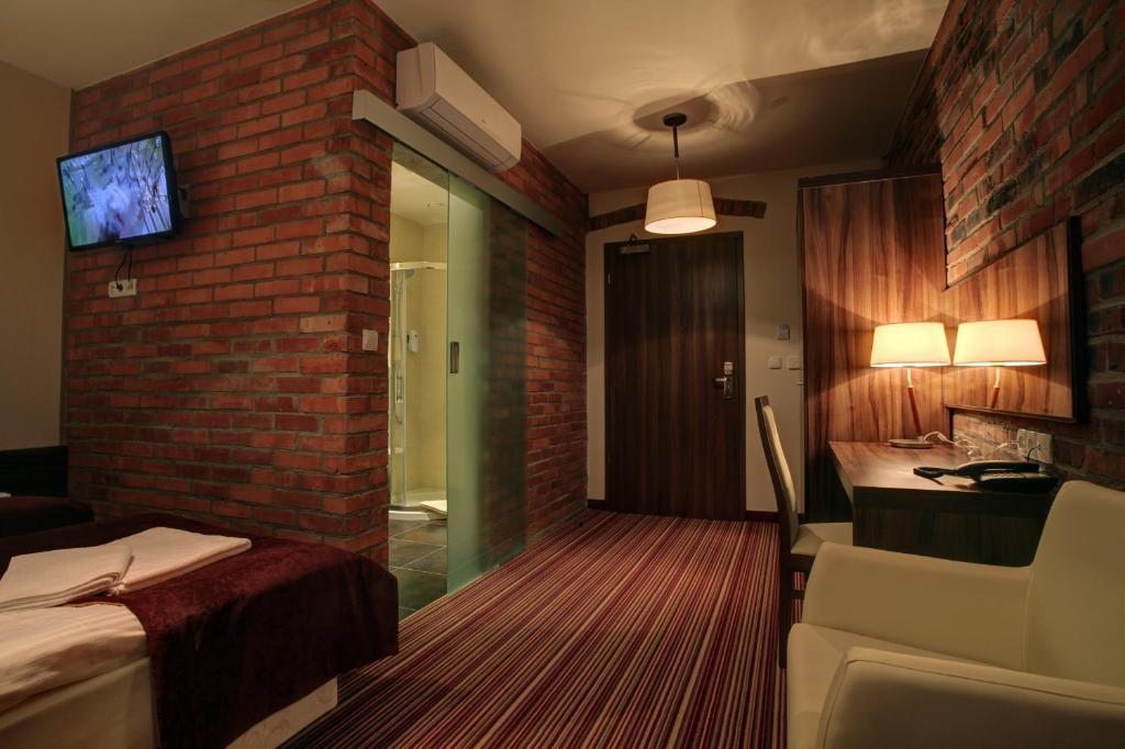 Łóżko lub łóżka w pokoju w obiekcie Browar CzenstochoviA Hotel&Spa