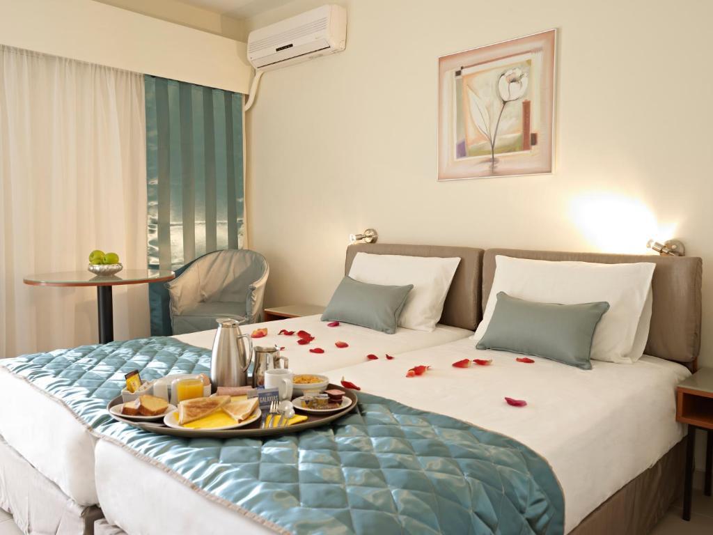 Cama o camas de una habitación en Hotel Galaxias