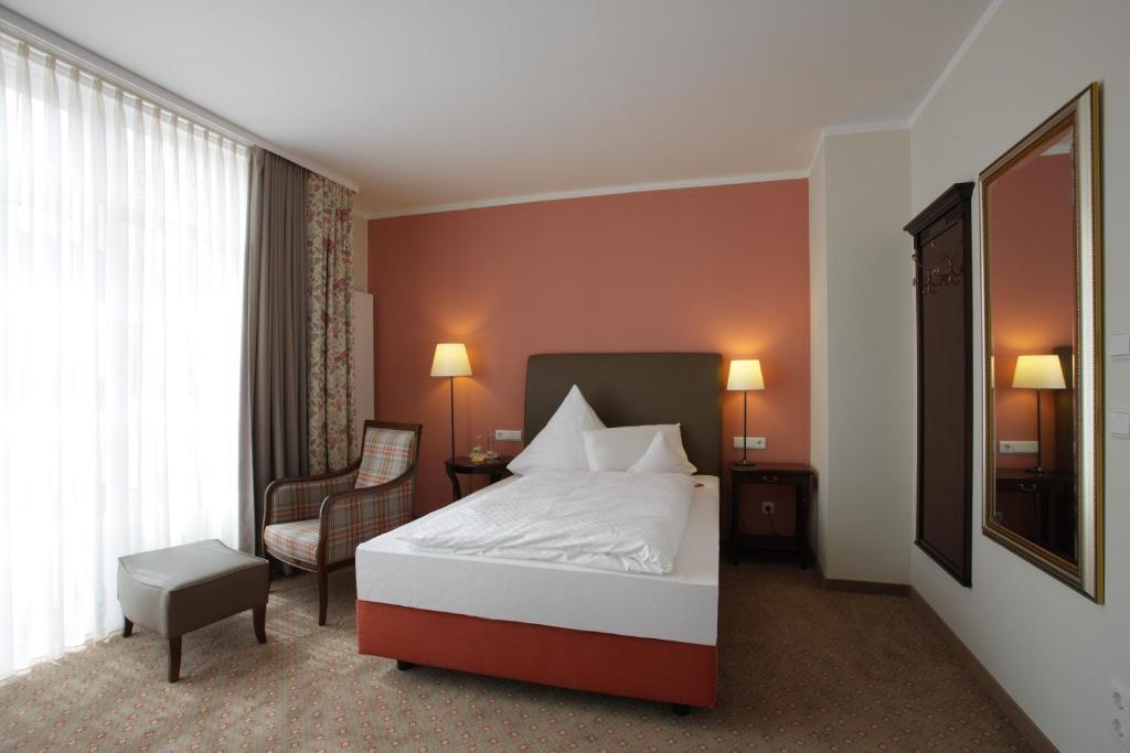 Giường trong phòng chung tại Hotel Gödecke