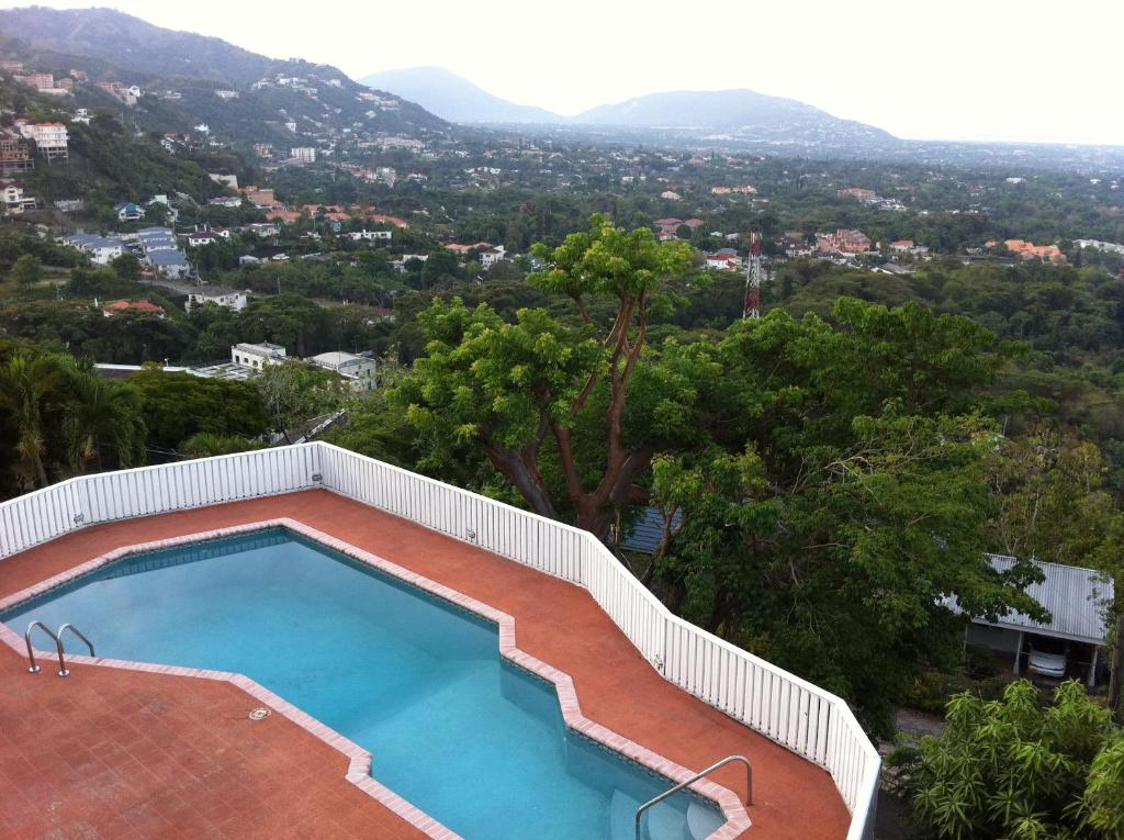 A view of the pool at Hill Top Kingston Jamaica or nearby