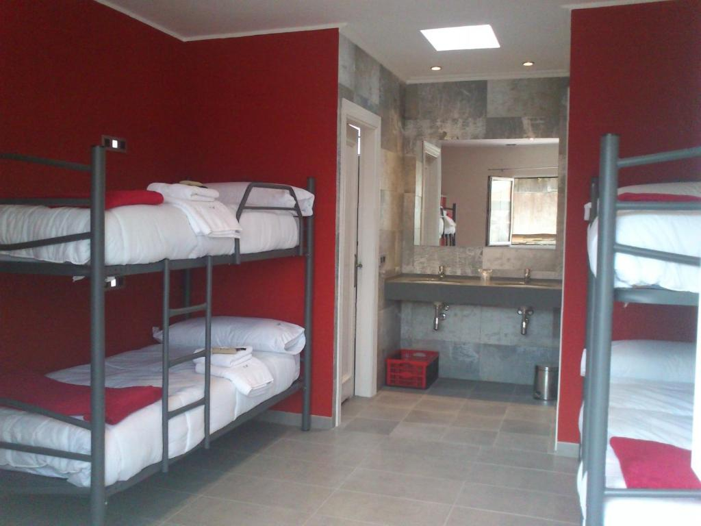 A bunk bed or bunk beds in a room at Cudillero Hostel frente Palacio-Museo Selgas