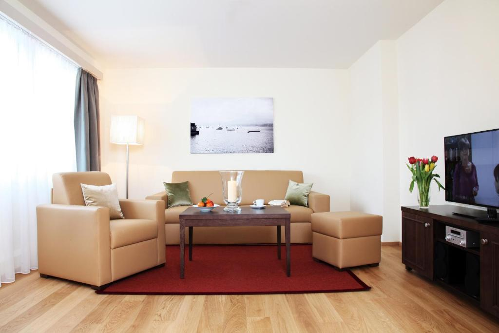 A seating area at City Stay Furnished Apartments - Kieselgasse