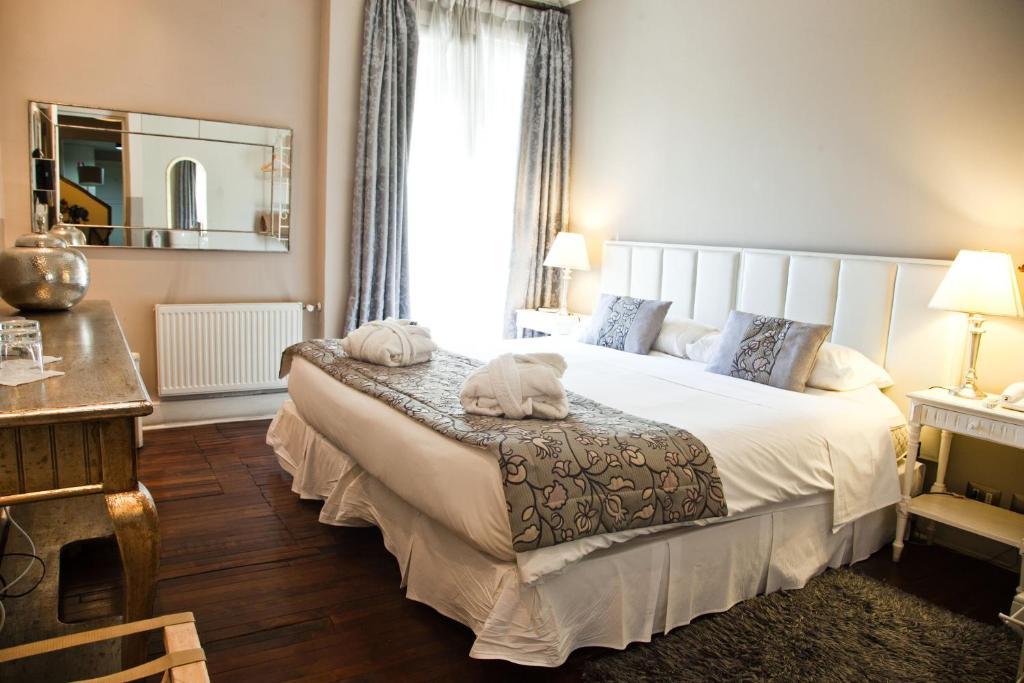 Cama o camas de una habitación en Mito Casa Hotel Boutique