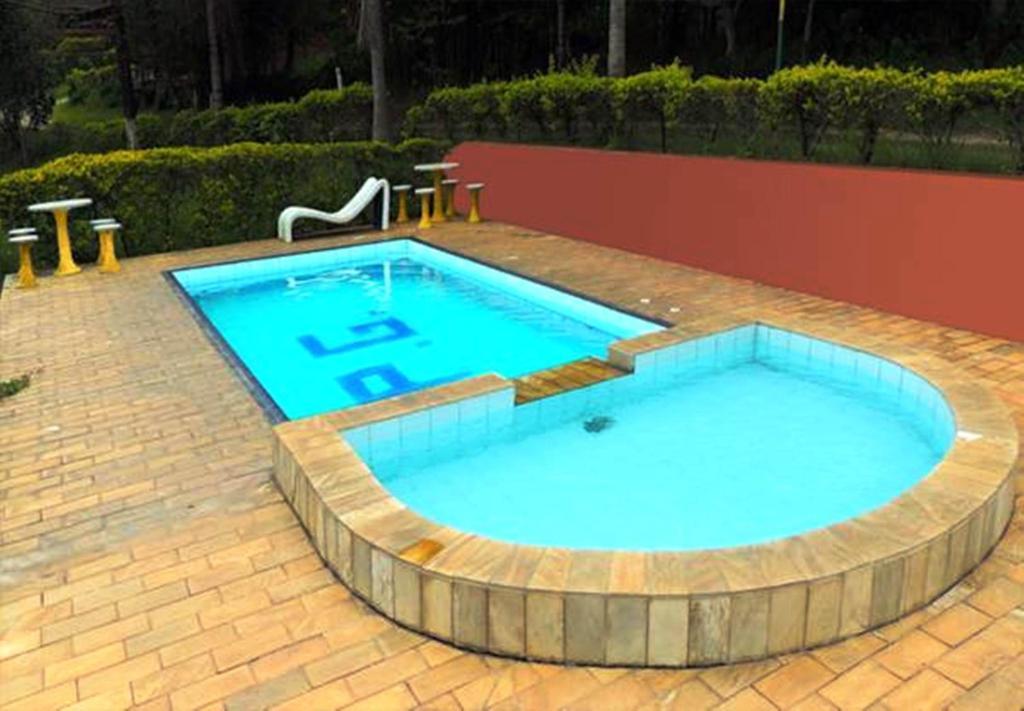 The swimming pool at or near Pousada Gruta do Anjo