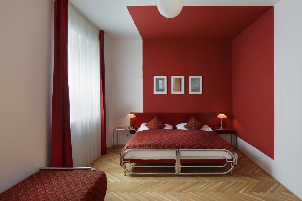 Letto o letti in una camera di AXA Hotel