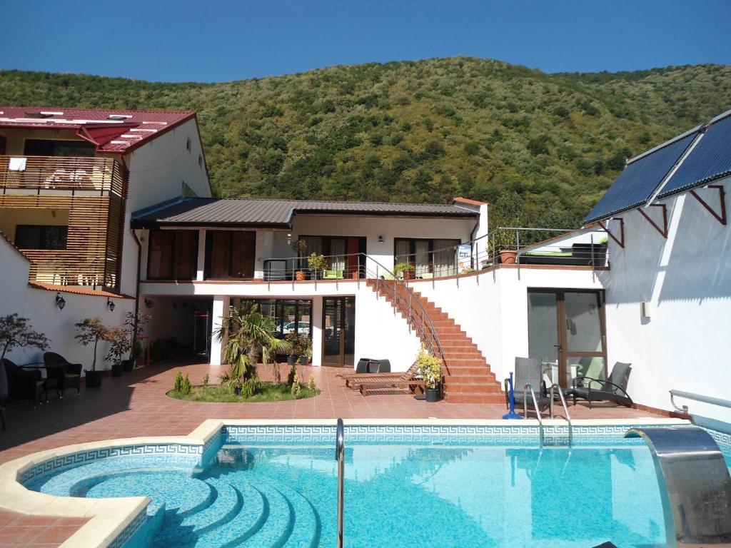 The swimming pool at or near Pensiunea La Dolce Vita