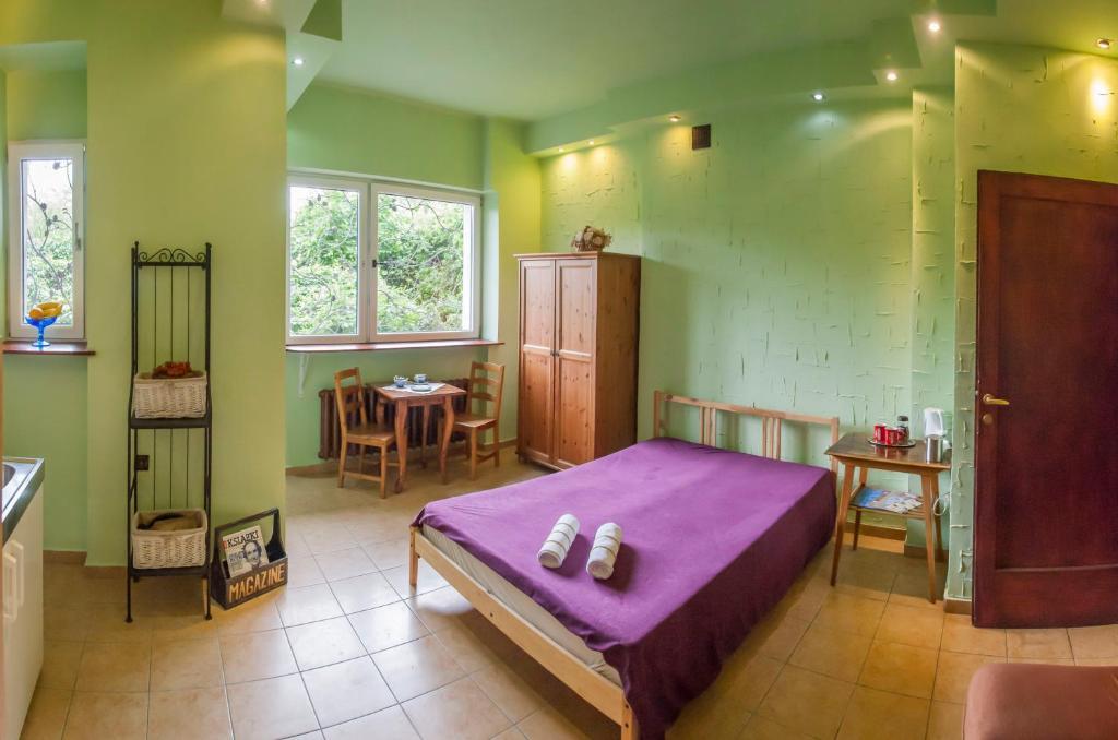 A bed or beds in a room at Studio Krowoderska