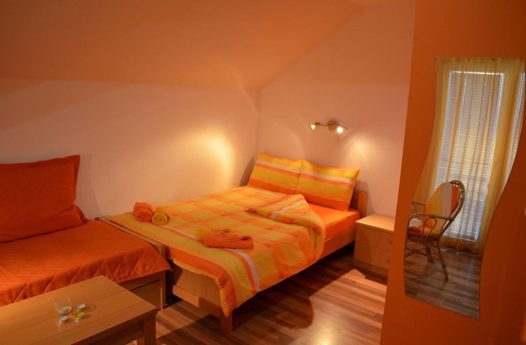 A bed or beds in a room at Villa Vesna