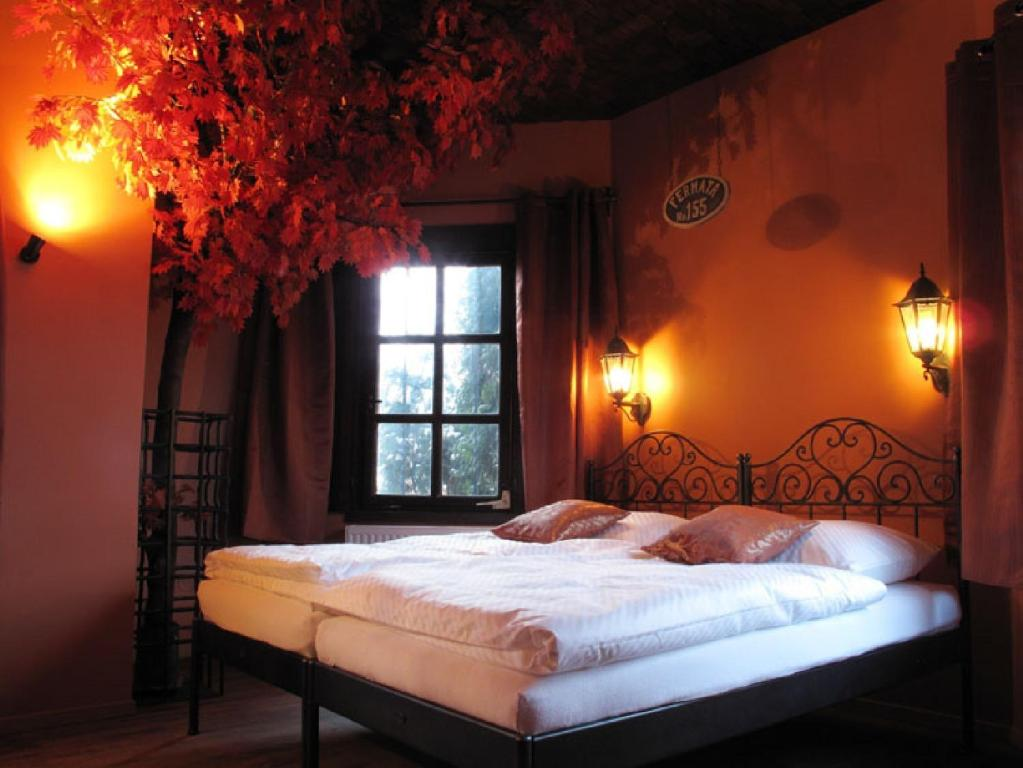 A bed or beds in a room at Penzion Fermata