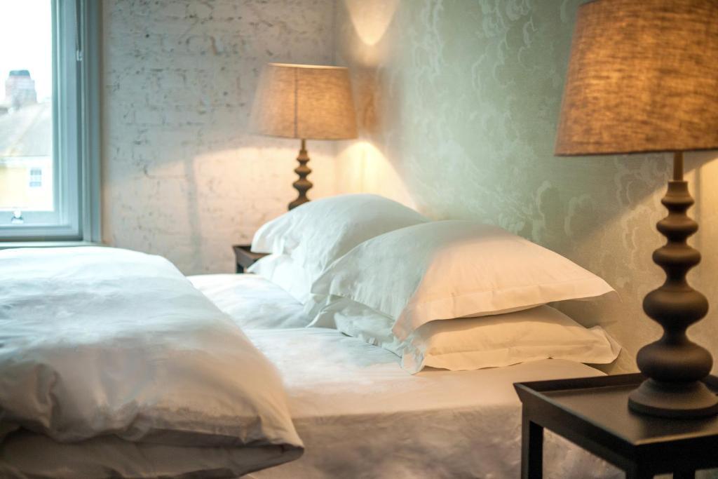 Un ou plusieurs lits dans un hébergement de l'établissement The Tommyfield Hotel