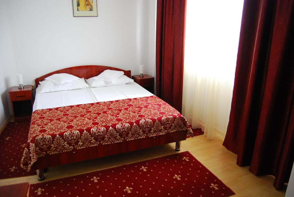 Ein Bett oder Betten in einem Zimmer der Unterkunft Dali Hotel