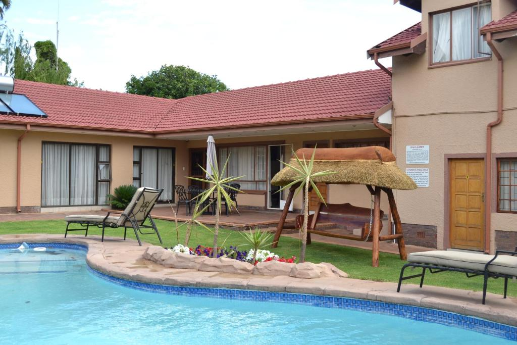 The swimming pool at or near Augustavilla St.Pio's Guest House