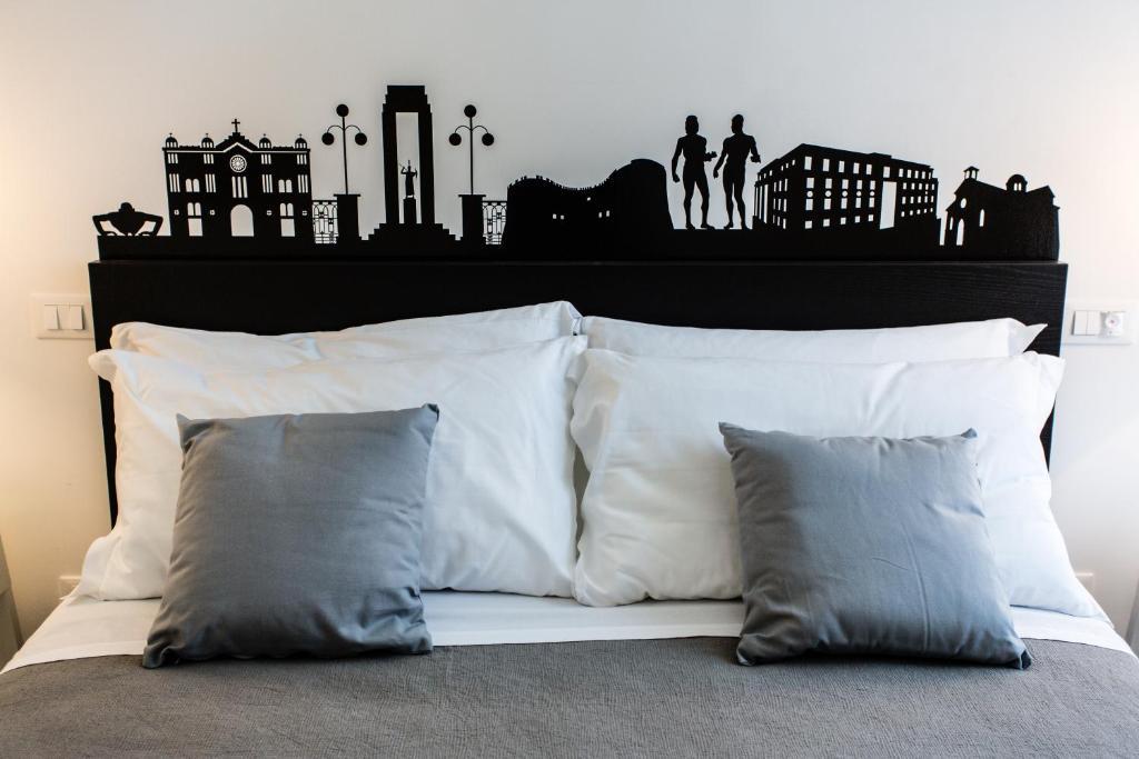Rhegion B&B tesisinde bir odada yatak veya yataklar
