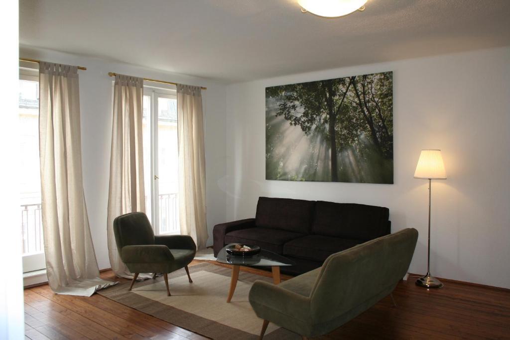 Ein Sitzbereich in der Unterkunft Apartment Mirabell
