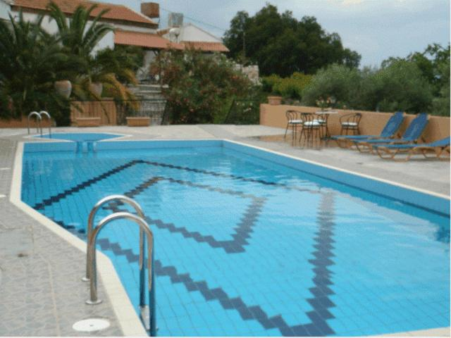 The swimming pool at or near Halases Apartments