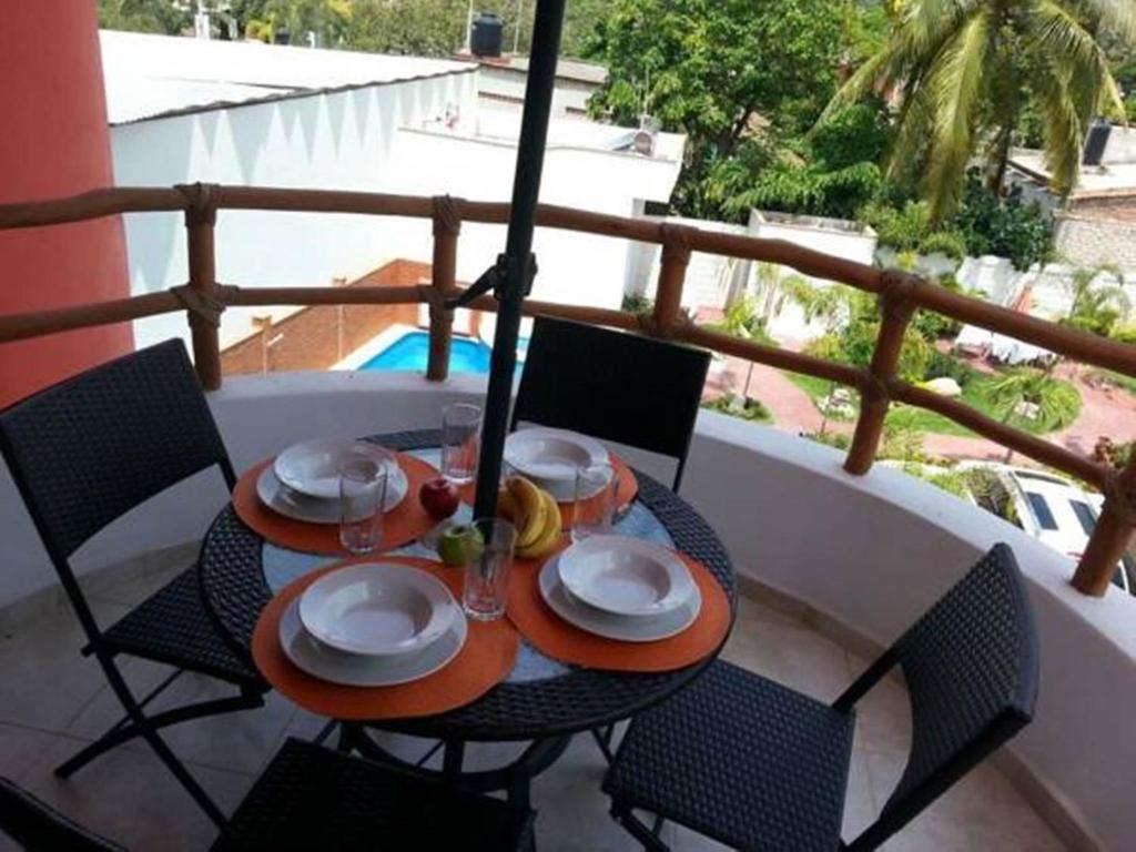 A balcony or terrace at Hotel y Suites Los Encantos