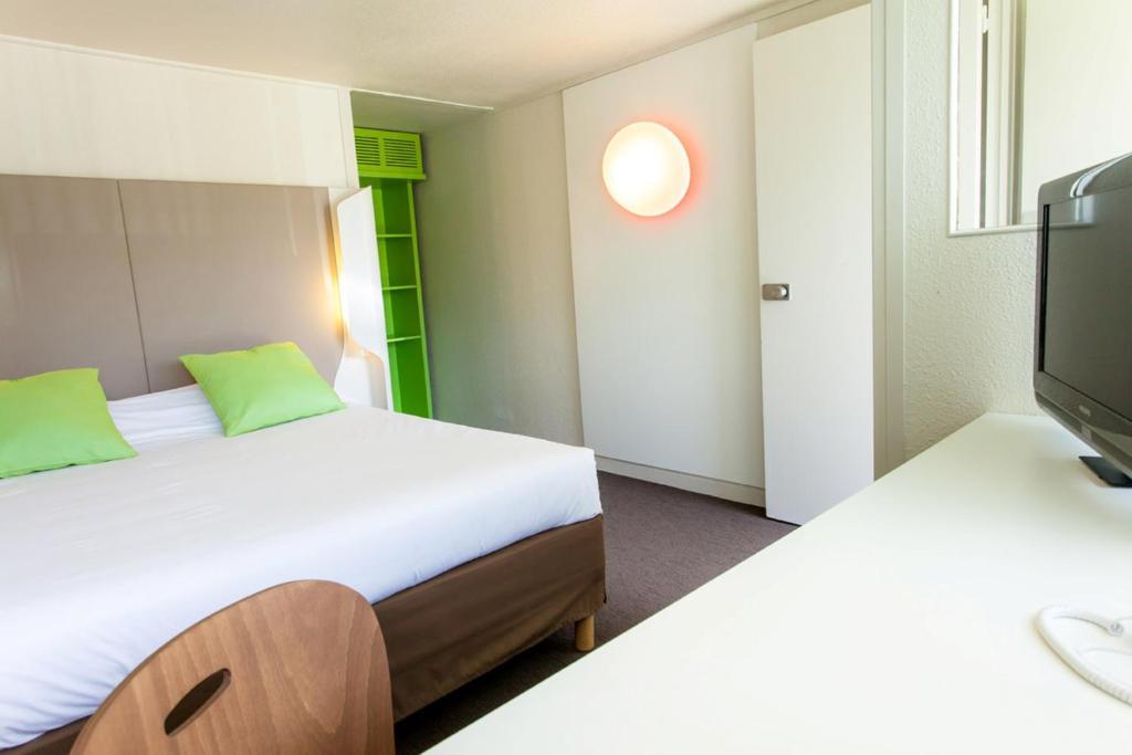 Un ou plusieurs lits dans un hébergement de l'établissement Campanile Montpellier Sud - A709