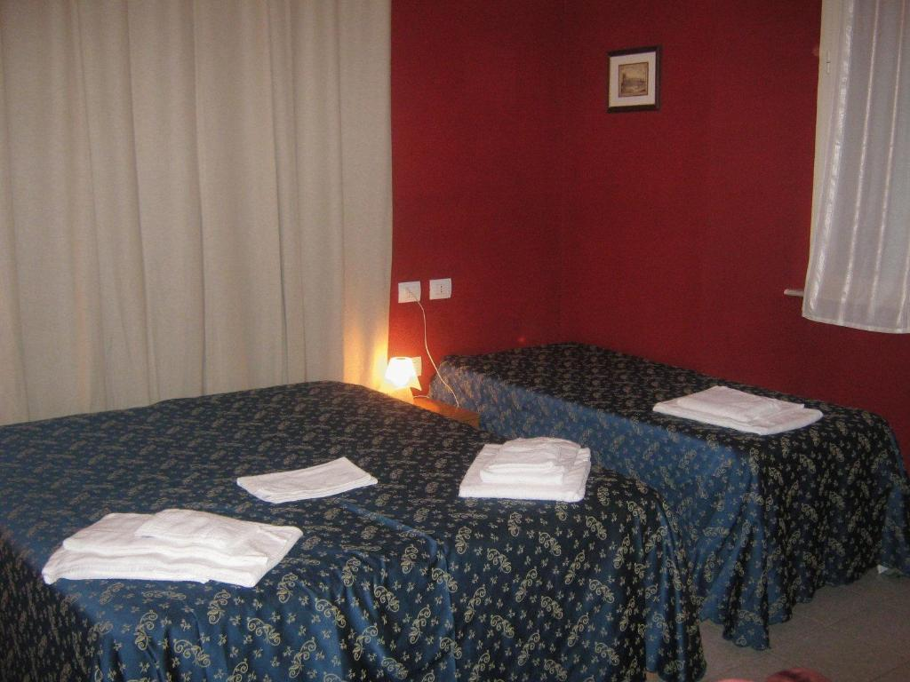 A bed or beds in a room at Hotel Ferraro