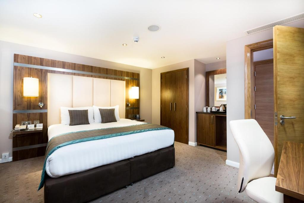 A bed or beds in a room at DoubleTree By Hilton Milton Keynes