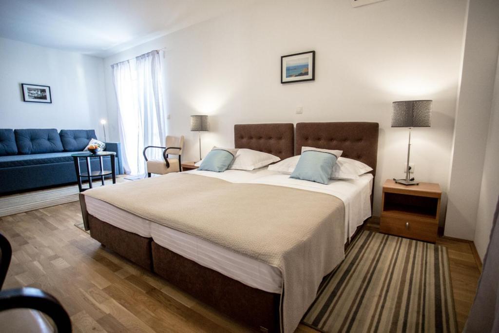 Letto o letti in una camera di Rooms Margarita