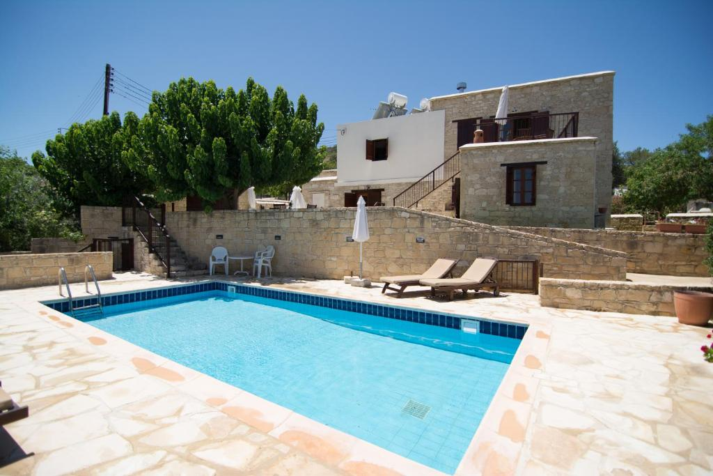 The swimming pool at or near Elpida's Stone Houses