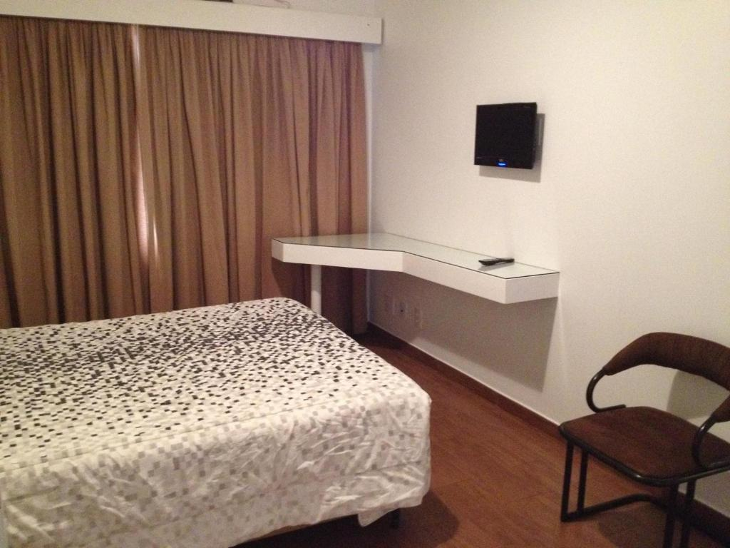 A bed or beds in a room at Residence Plaza Flat