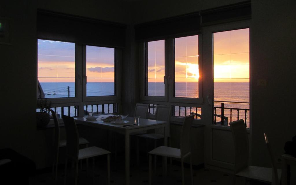 A restaurant or other place to eat at Albergue da Costa