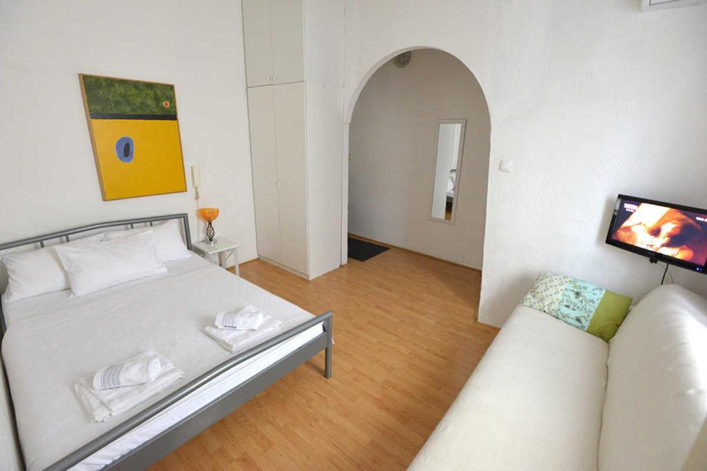 A bed or beds in a room at Apartment Kalemegdan
