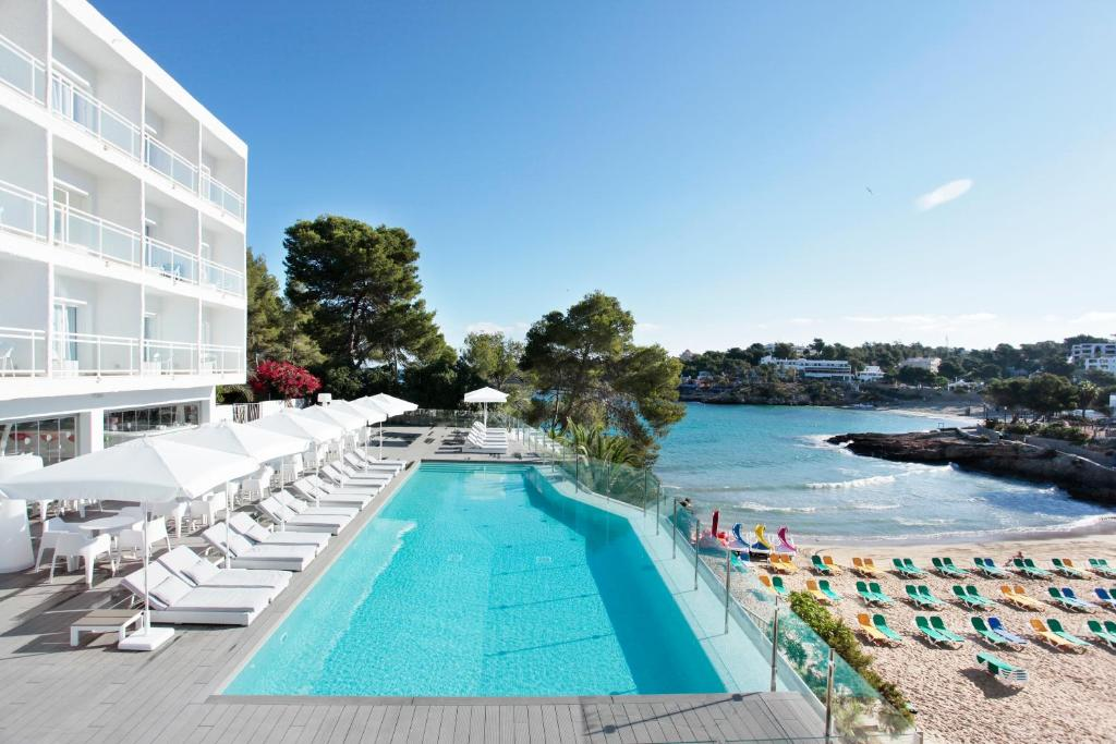 The swimming pool at or near Grupotel Ibiza Beach Resort - Adults Only