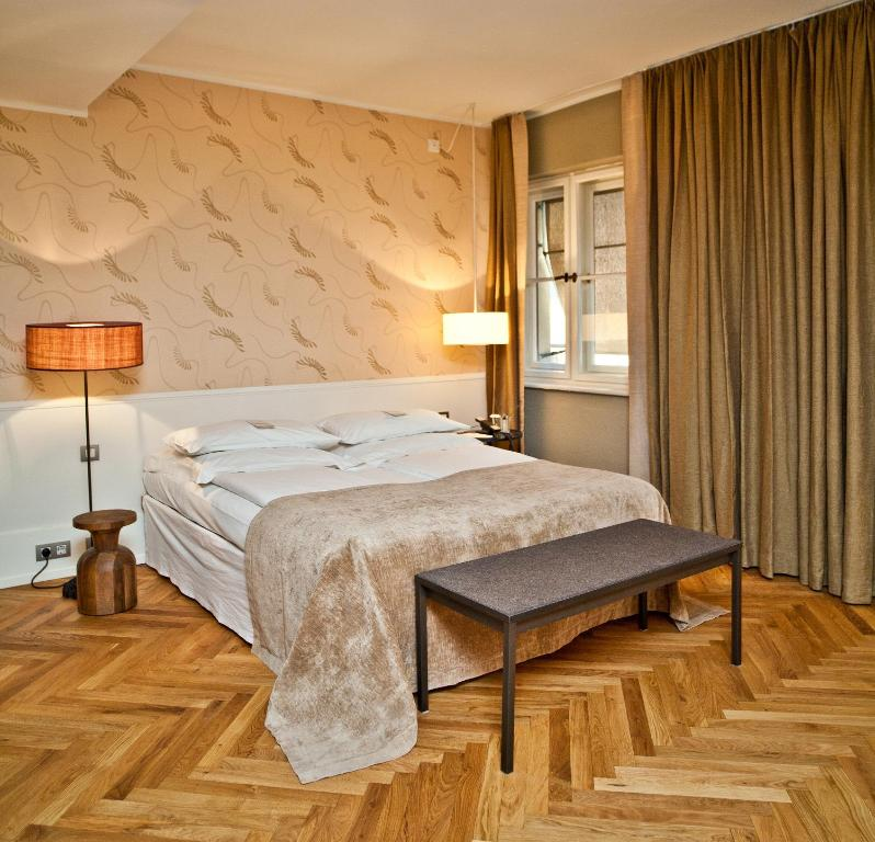 A bed or beds in a room at CORTIINA Hotel