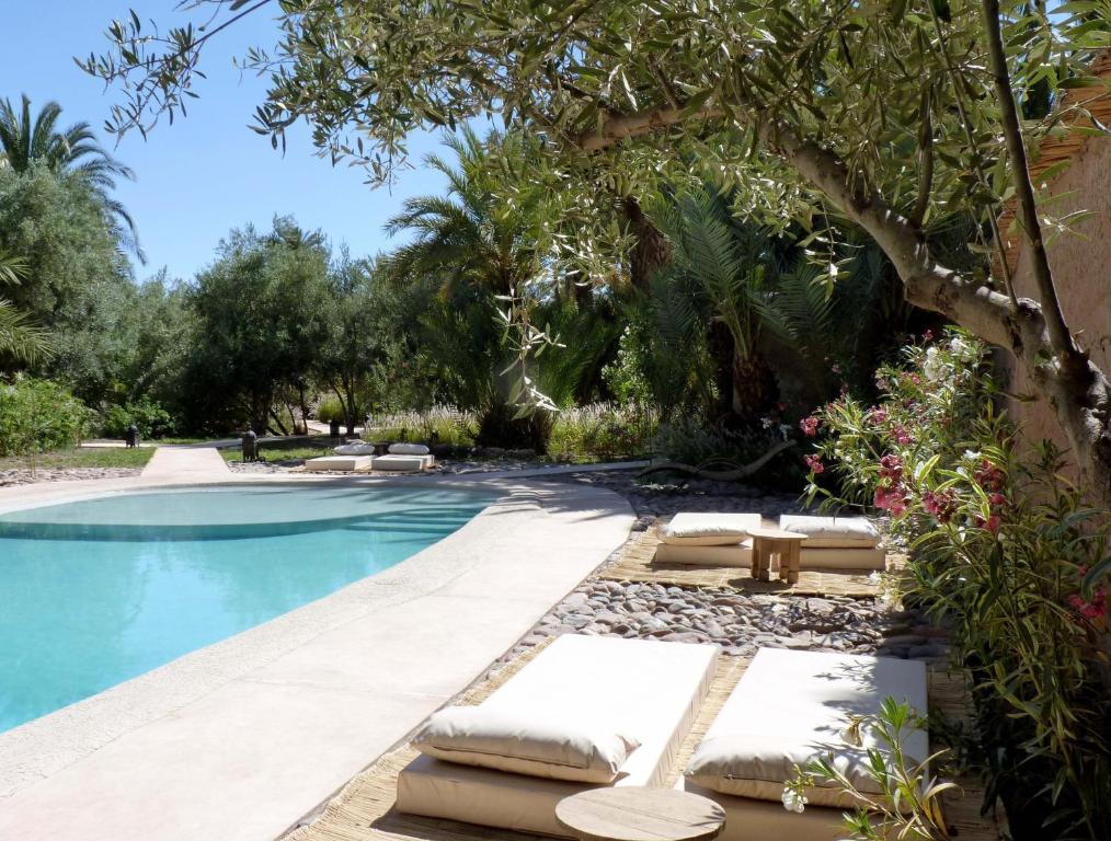 Het zwembad bij of vlak bij L'Ma Lodge