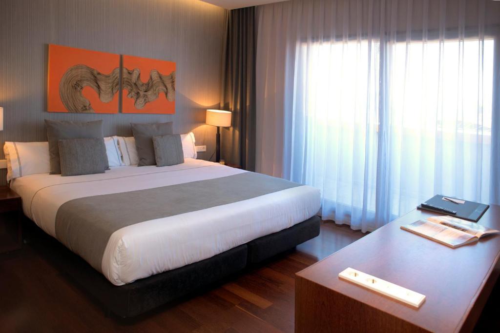 Cama o camas de una habitación en Hotel Carris Marineda
