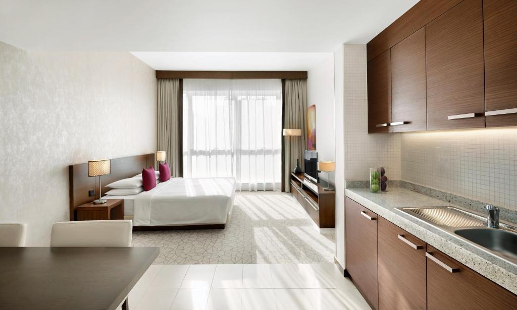 A kitchen or kitchenette at Hyatt Place Residences Dubai / Al Rigga