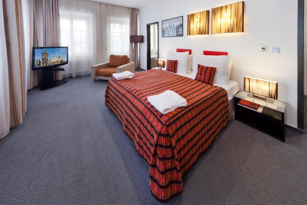 מיטה או מיטות בחדר ב-Prague Inn
