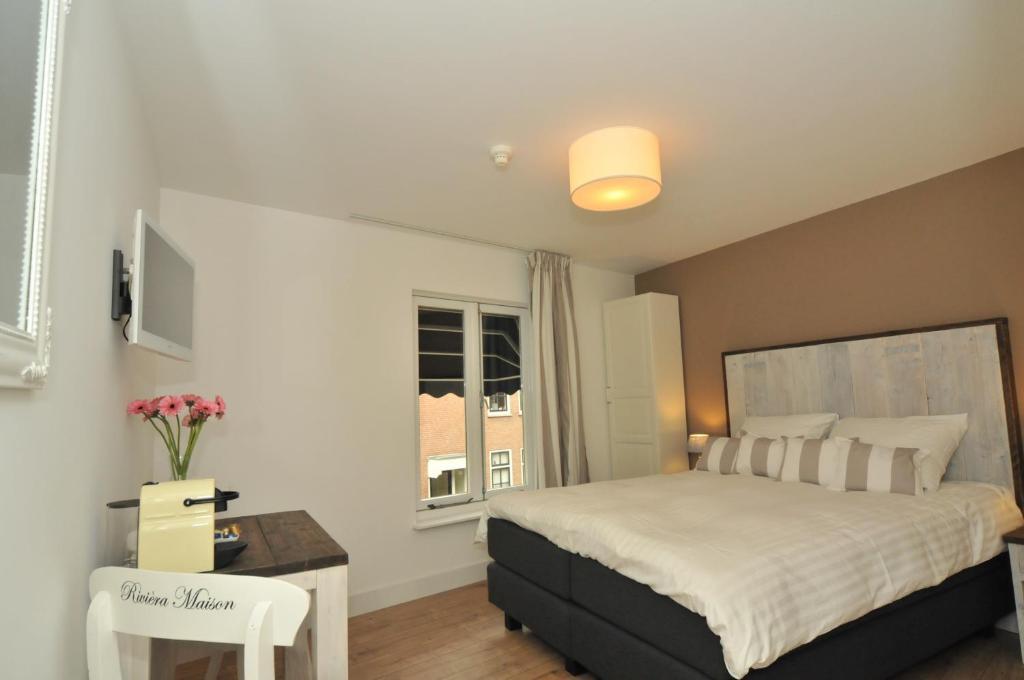 Ein Bett oder Betten in einem Zimmer der Unterkunft Bed & Breakfast Madeleine