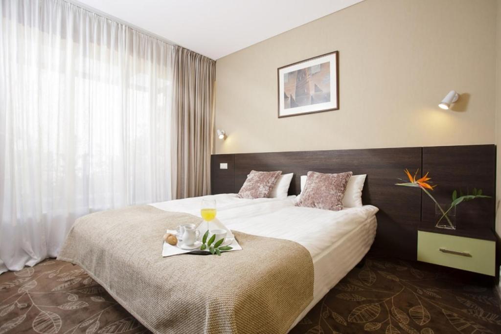 Lova arba lovos apgyvendinimo įstaigoje Hotel Babilonas