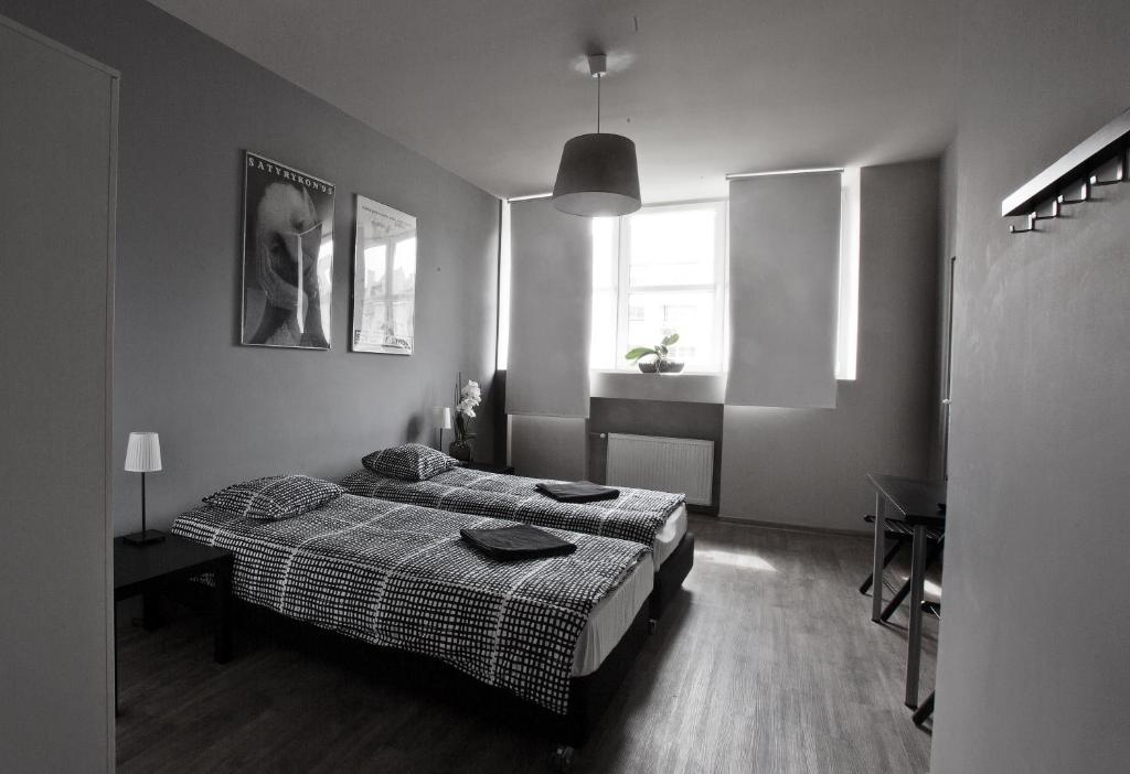 A bed or beds in a room at Corner Hostel