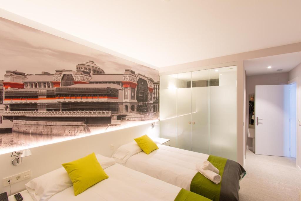 Cama ou camas em um quarto em Bilbao City Rooms