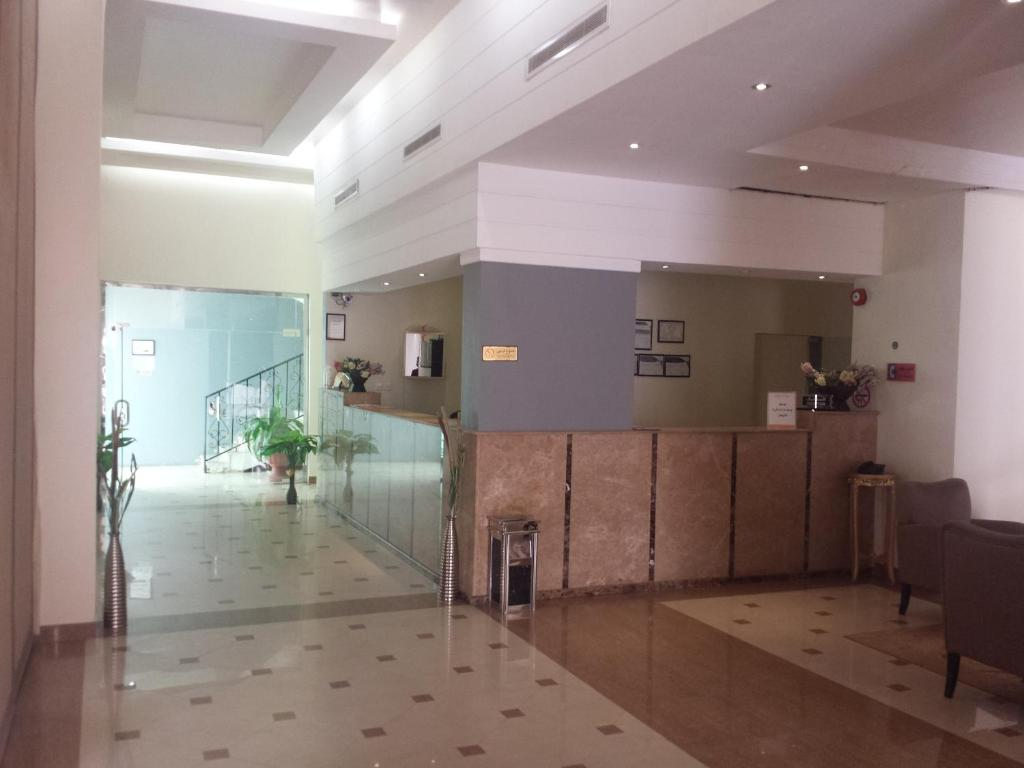 The lobby or reception area at Romansiyah Aparthotel