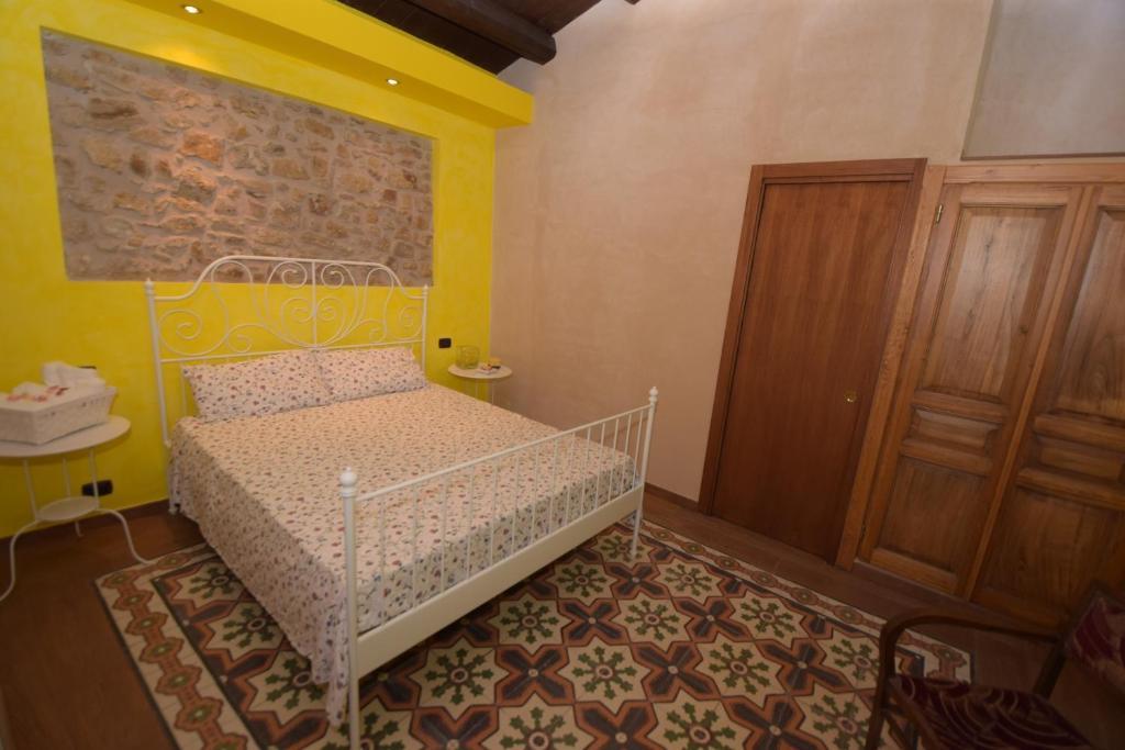 Ein Bett oder Betten in einem Zimmer der Unterkunft Antichi Quartieri
