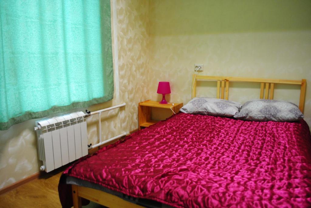 Кровать или кровати в номере Хостел ПушкинЪ