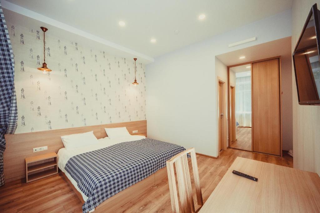 Кровать или кровати в номере Гостиница Палуба