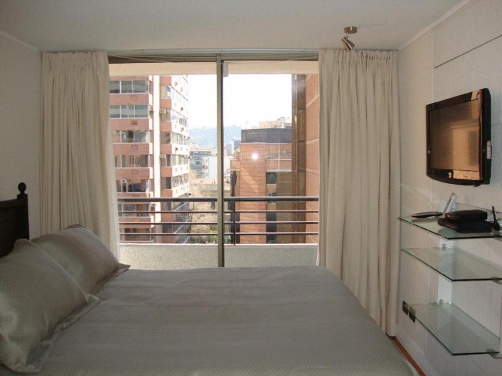 Cama ou camas em um quarto em MG Apartments Providencia