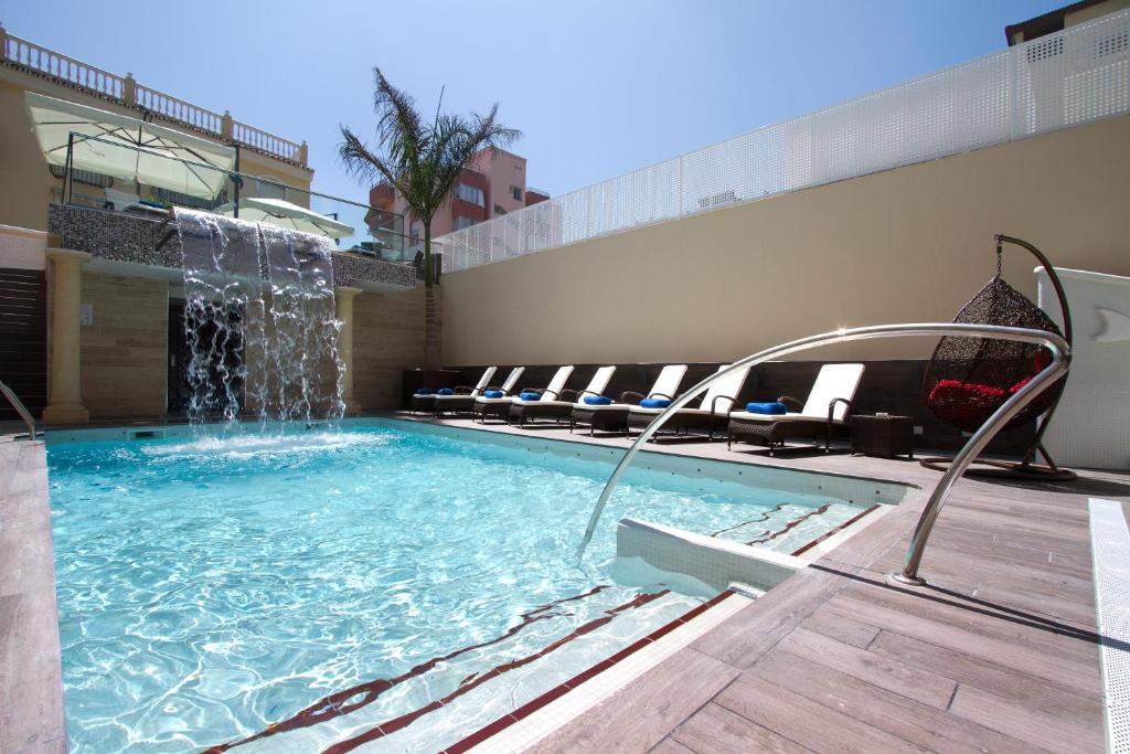 The swimming pool at or near El Tiburon Boutique Hotel & Spa (Adults Recommended)