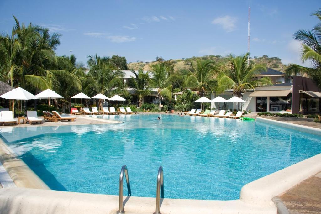 Piscine de l'établissement Punta Sal Suites & Bungalows Resort ou située à proximité