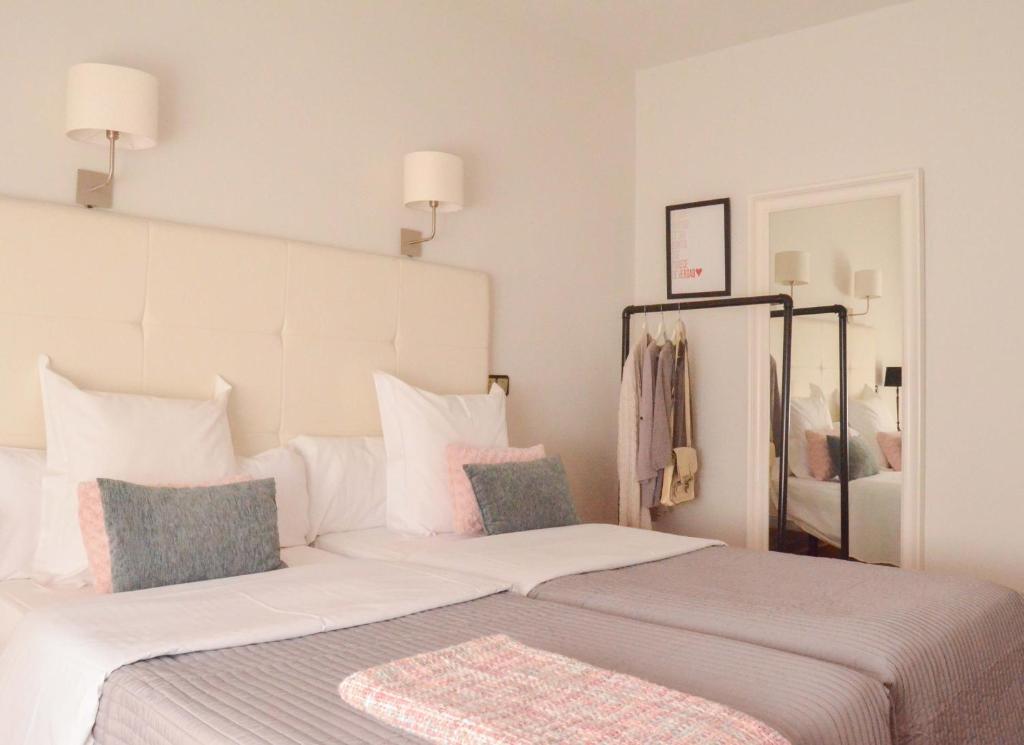 Cama o camas de una habitación en Hostal Carlos V