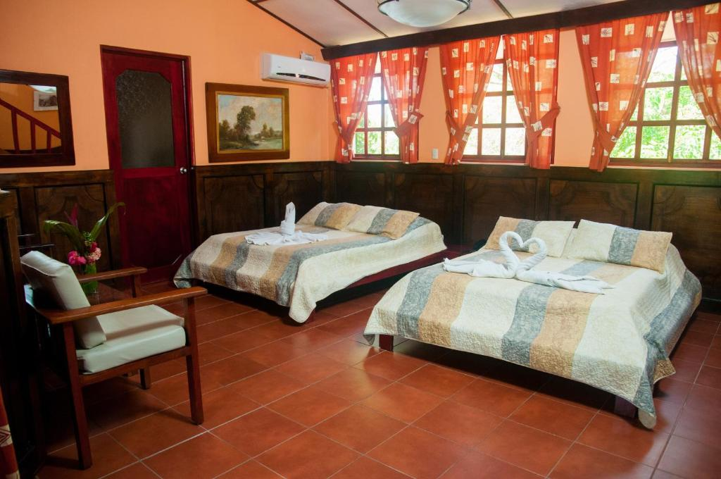 Łóżko lub łóżka w pokoju w obiekcie Hotel Playa Bejuco