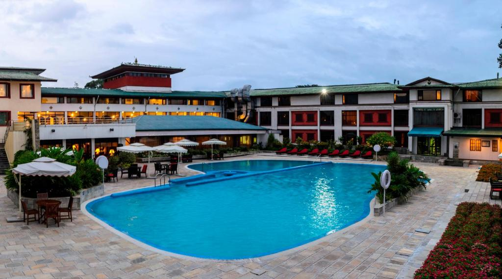 The swimming pool at or near Hotel de l' Annapurna