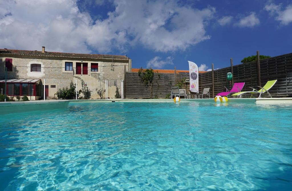 The swimming pool at or near Les Chambres de Montplaisir